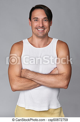 handsome smiling muscular man isolated - csp50872759