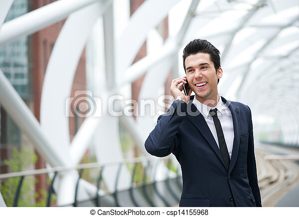 Handsome young businessman on the phone at station - csp14155968