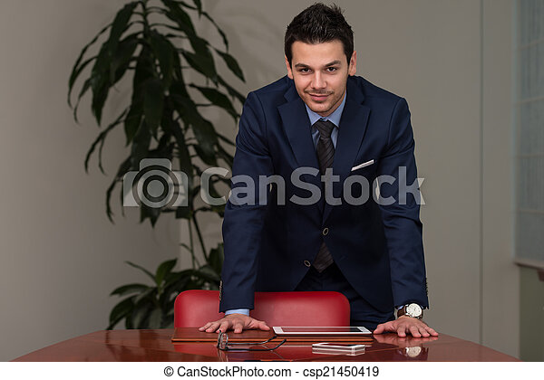 Handsome Young Businessman Portrait In His Office - csp21450419
