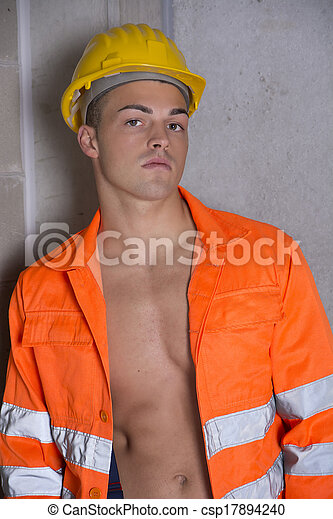 Handsome Young Construction Worker With Orange Suit And Hardhat Stock Photo