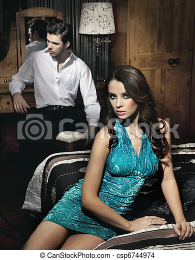 Handsome young couple resting in bedroom before night party - csp6744974