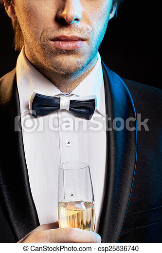 Handsome young guy drinking a champagne - csp25836740