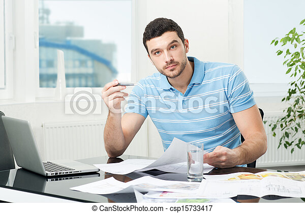 handsome young interior designer at workplace - csp15733417
