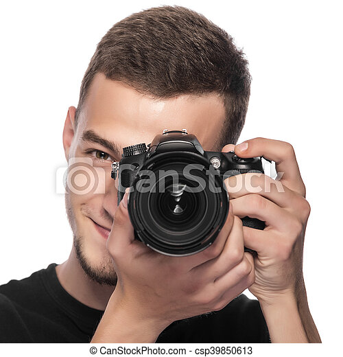 Handsome young man holding a DSLR camera. - csp39850613