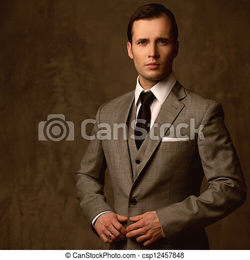 Handsome young man in classic suit - csp12457848