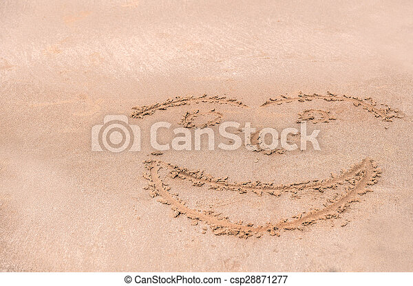 Handwrite face on the sand at the beach - csp28871277