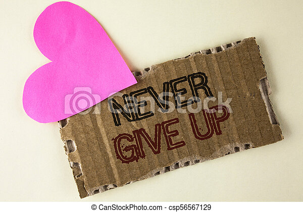 Handwriting text Never Give Up  Concept meaning Be persistent motivate  yourself succeed never look back written on Tear Cardboard Piece on the  plain