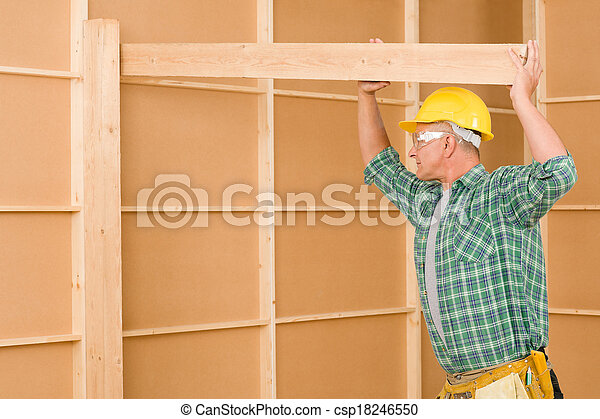 Handyman carpenter mature fitting wooden beam - csp18246550