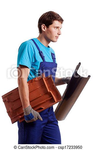 Handyman holding a gutter - csp17233950