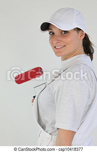 handywoman painting a wall - csp10418377