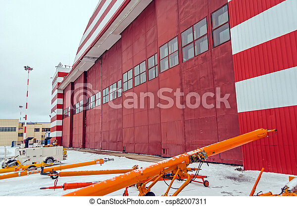 Hangar for aircraft maintenance at the airport, winter snowy landscape. - csp82007311