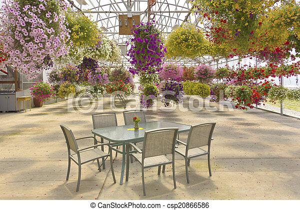 Hanging flower baskets outdoor seating. - csp20866586