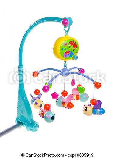 Hanging toy attached to a baby cot. - csp10805919