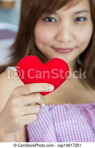 Happiness women show with heart shape in hands - csp14817261