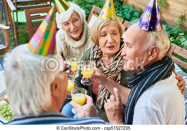 Happy 70th Birthday Group Of Cheerful Senior People Wearing Holiday