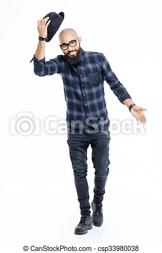 Happy african american man greeting and taking off his hat  - csp33980038