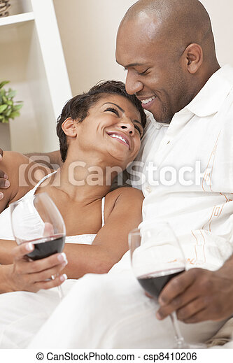 Happy African American Man & Woman Couple Drinking Wine - csp8410206