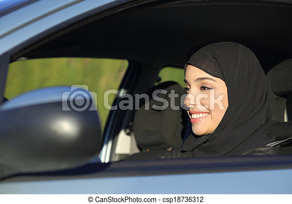 Happy arab saudi woman driving a car - csp18736312