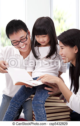 Happy asian family studing together. Parent helping daughter  reading book - csp5432829
