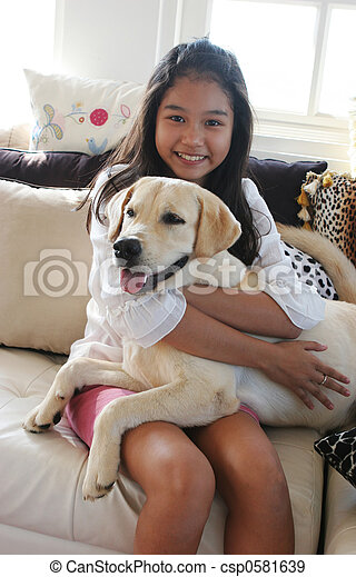Happy Asian girl with her pet dog - csp0581639