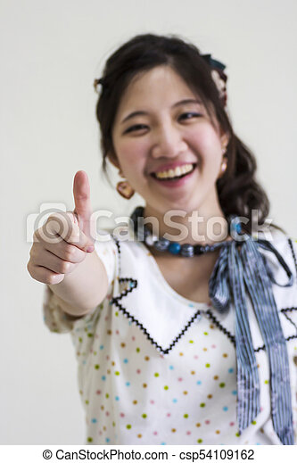 Happy asian woman show thumps up - csp54109162