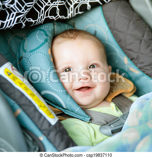 Happy baby buckled into rear-facing car seat - csp19837110