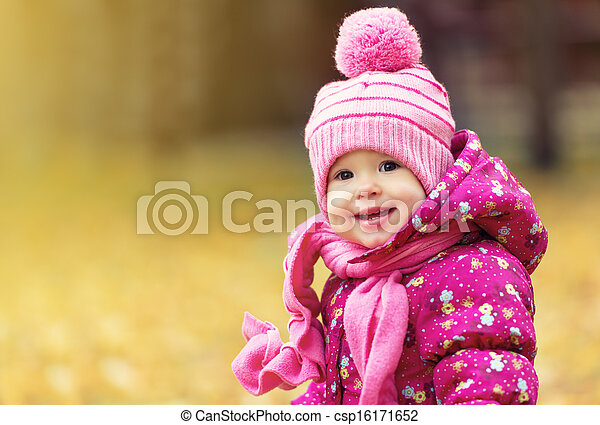 happy baby girl child outdoors in the park in autumn - csp16171652