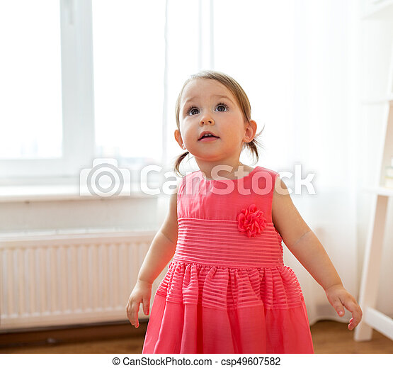happy baby girl in dress at home - csp49607582