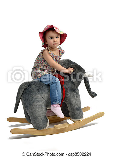 Happy baby girl is swinging on see-saw - csp8502224
