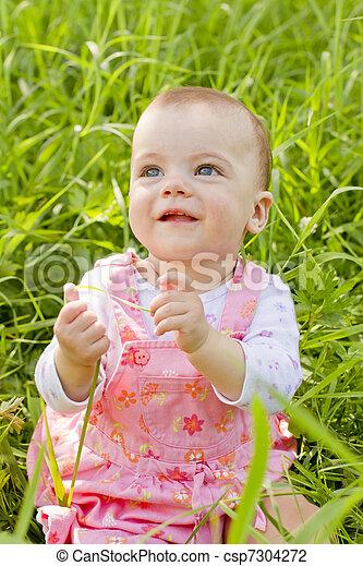 Happy baby girl on grass - csp7304272