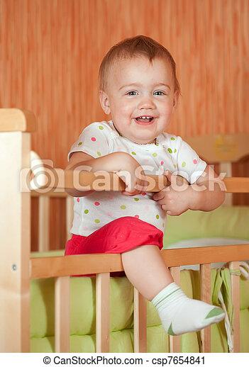 Happy baby in crib - csp7654841