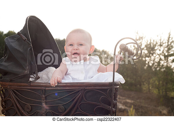 Happy baby in her pram - csp22322407
