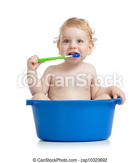 Happy baby kid brushing teeth sitting in basin - csp10323692