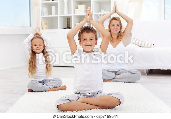 Happy balanced life - people doing yoga exercise - csp7199541