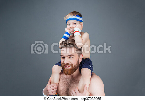 Happy bearded man with little son sitting on his shoulders - csp37033065