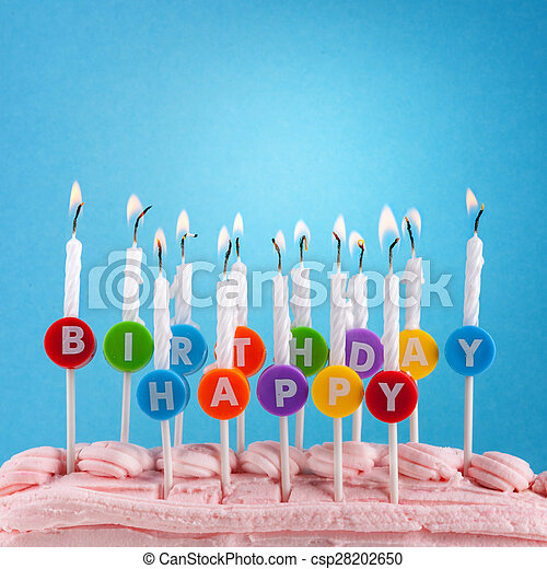 Happy birthday candles on blue background - csp28202650