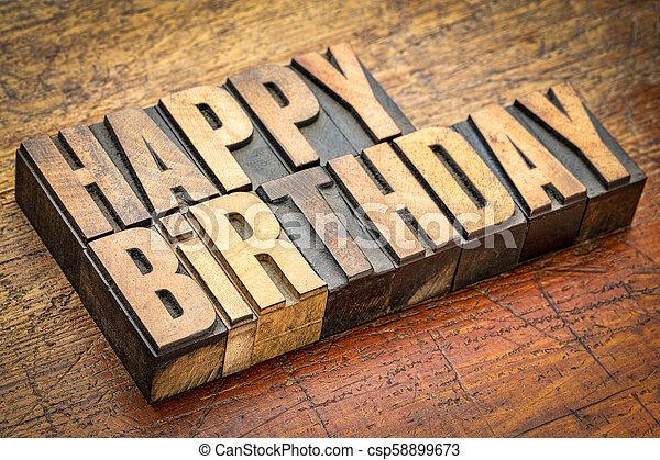 Happy Birthday greetings in letterpress wood type - csp58899673