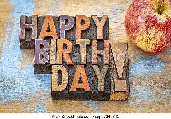 Happy Birthday in wood type with apple - csp37348745