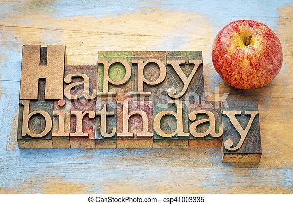 Happy Birthday in wood type with apple - csp41003335