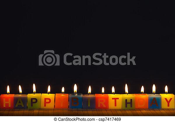 Happy birthday lit candles - csp7417469