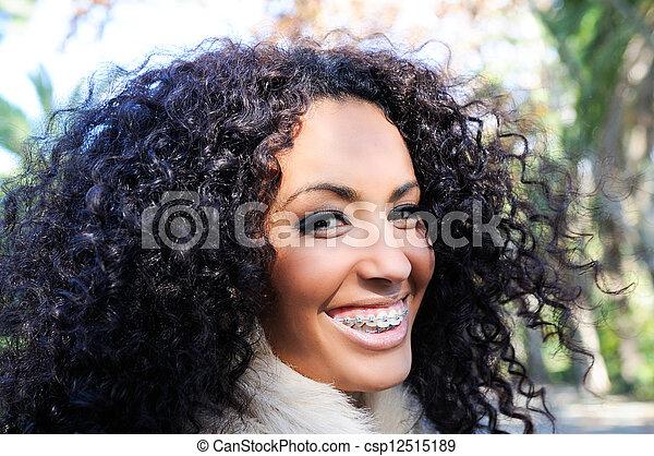 Happy black girl with braces  - csp12515189