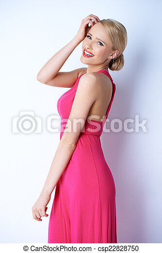 Happy Blond Young Woman in Pink Dress - csp22828750