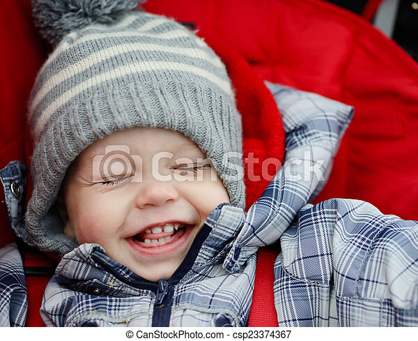 happy boy in stroller - csp23374367