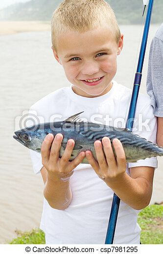 happy boy showing a fish he caught - csp7981295