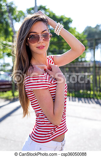 dcdff0417e57 Happy bright young beautiful girl smiling on the nature posing in  sunglasses, fashion lifestyle -