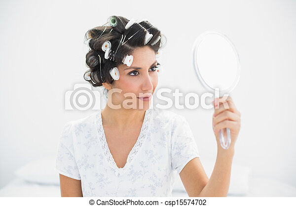 woman holding hand mirror. Happy Brunette In Hair Rollers Holding Hand Mirror - Csp15574702 Woman