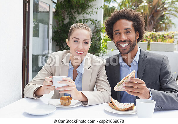 Happy business people on their lunch - csp21869070