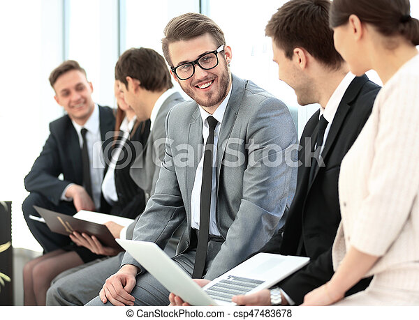 Happy business people talking on meeting at office - csp47483678