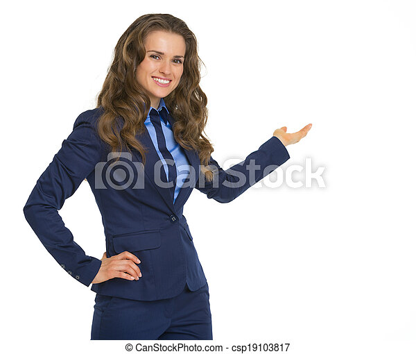 Happy business woman pointing on copy space - csp19103817