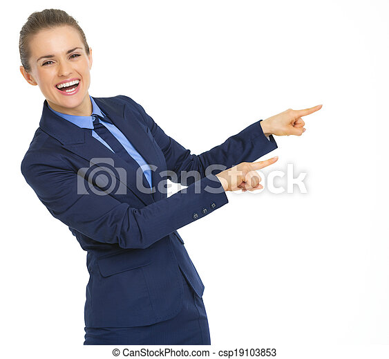 Happy business woman pointing on copy space - csp19103853